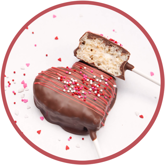 Heart shaped rice krispy treat on a stick and covered in chocolate.