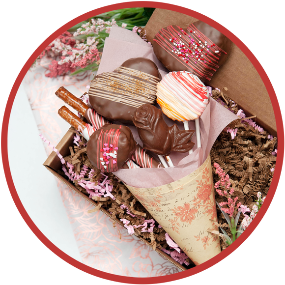 Large valentine chocolate bouquet with chocolate covered pretzel rods, heart krispie pops, and rose lollipops.