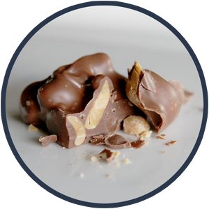 Peanuts covered in chocolate! Delicious peanut cluster made by Kalona Chocolates.