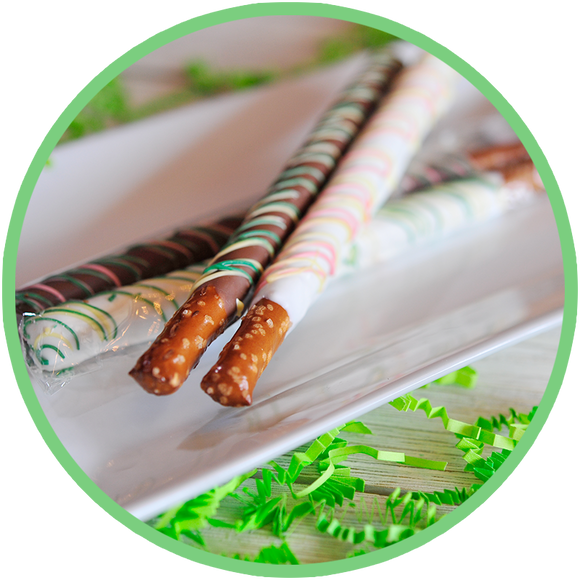 Brightly colored chocolate dipped pretzel rod sticks for Easter baskets.