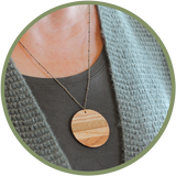 Beautiful wood necklace on a long chain made in Kalona Iowa.