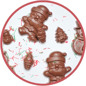 Hand molded chocolate Santas made in Kalona, Iowa.