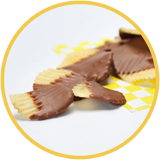 Chocolate covered potato chips are a unique gift for those that like sweet and salty treats. These chocolate covered chips were handmade in Kalona, Iowa.