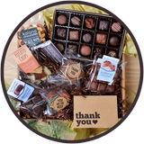 Large chocolate gift boxes include a thank you card and handmade chocolates from Kalona, Iowa.
