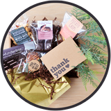 Chocolate gift boxes include a thank you card and handmade chocolates from Kalona, Iowa.