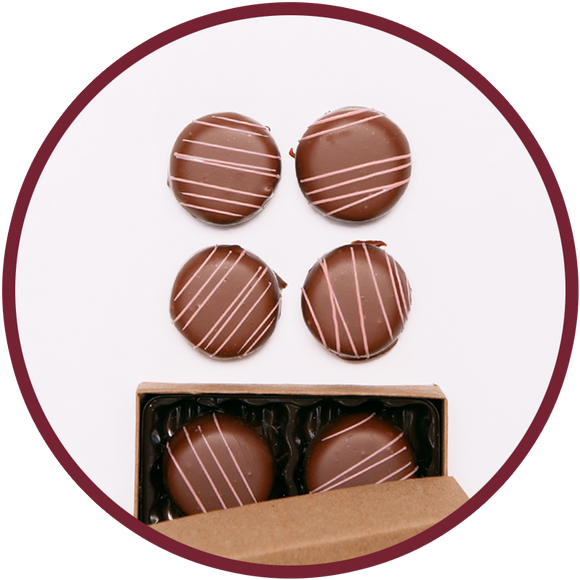 Raspberry chocolate truffles handmade in Kalona, Iowa in a small box.