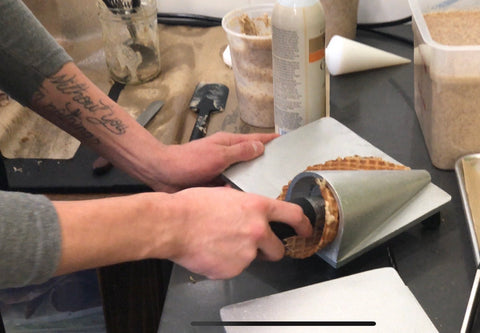 hand rolling waffle cones