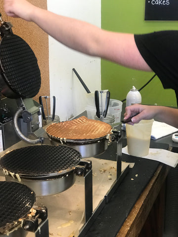 waffle cones being made on an iron