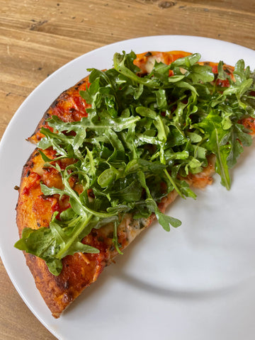 Annie's Organic Margherita Pizza topped with arugula