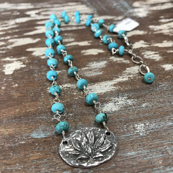 100 Sterling silver and faceted turquoise necklace with sterling silver lotus flower pendant. 17.25
