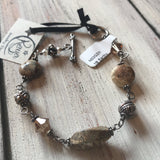 "118 Sterling silver wire wrap jasper bracelet. 7.5"" with toggle closure"