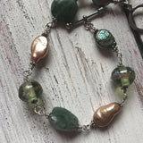 "122 Sterling silver, freshwater pearl and mixed gemstone bracelet. 8.5"" with toggle closure"