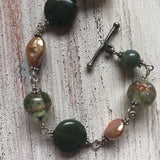 "123 Sterling silver, freshwater pearl and mixed gemstone bracelet. 7.5"" with toggle closure"