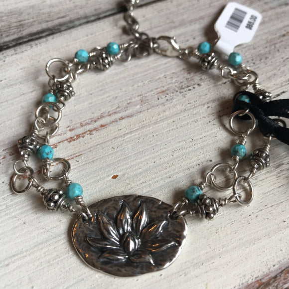 140 Sterling Silver Lotus flower bracelet with faceted turquoise. 7.5
