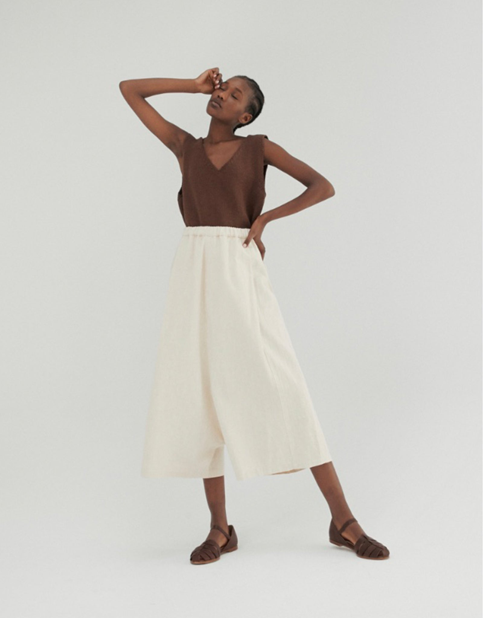 Model in Monica Cordera  Relaxed Ramie Pant in cream, and Jelly Sandel in brown leather from Shop FAWN