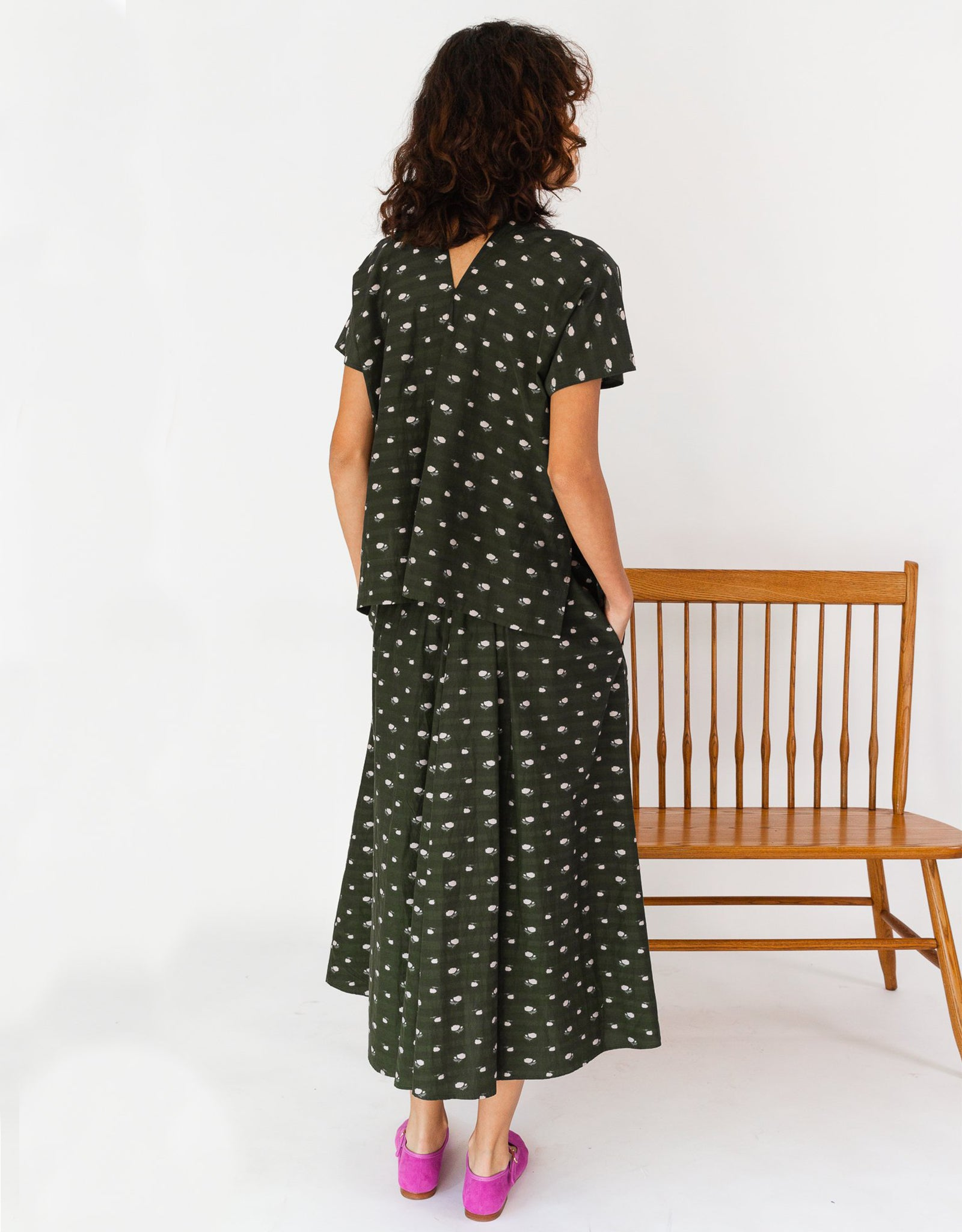 Model in Caron Callahan  patterned olive Selma dress from Shop FAWN