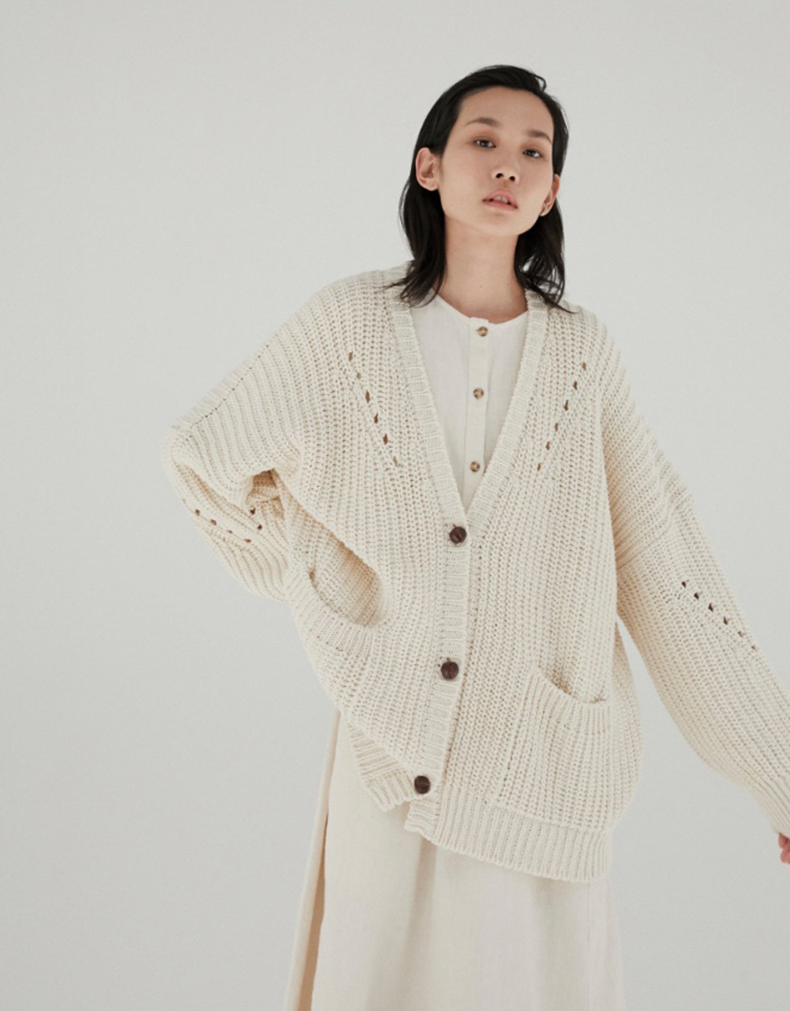 Model in cream Monica Cordera chunky oversized cardigan at Shop FAWN Toronto