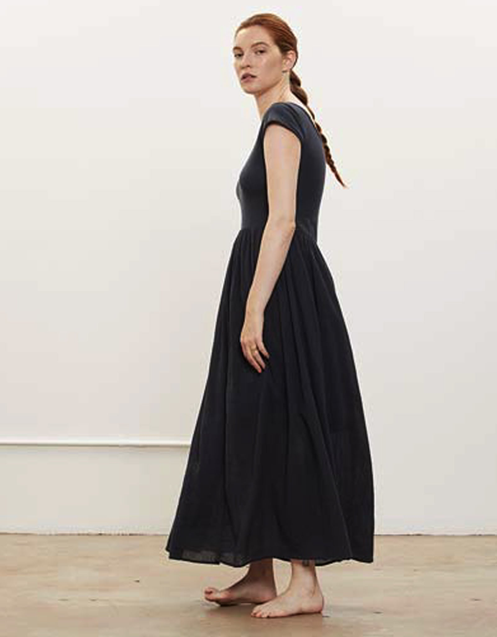 Model wears Black Crane Jersey Top Dress in Black . Available at FAWN Toronto.
