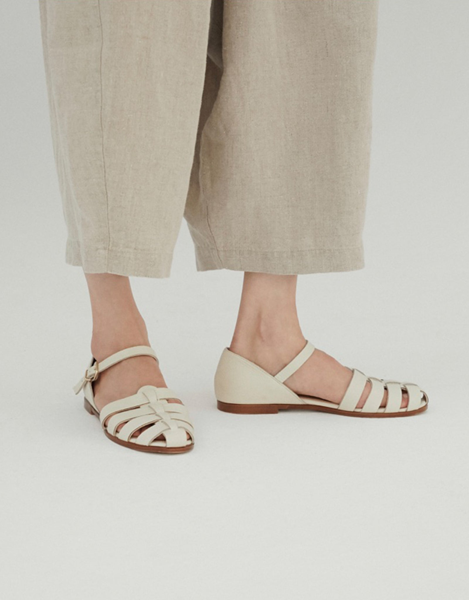 Close up of Monica Cordera Leather Jelly Sandals in Ivory.  Available at FAWN Toronto.