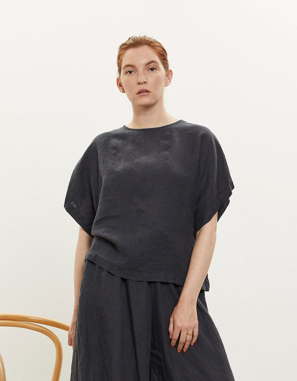 Model wears Black Crane Box top in Black. Available at FAWN Toronto.