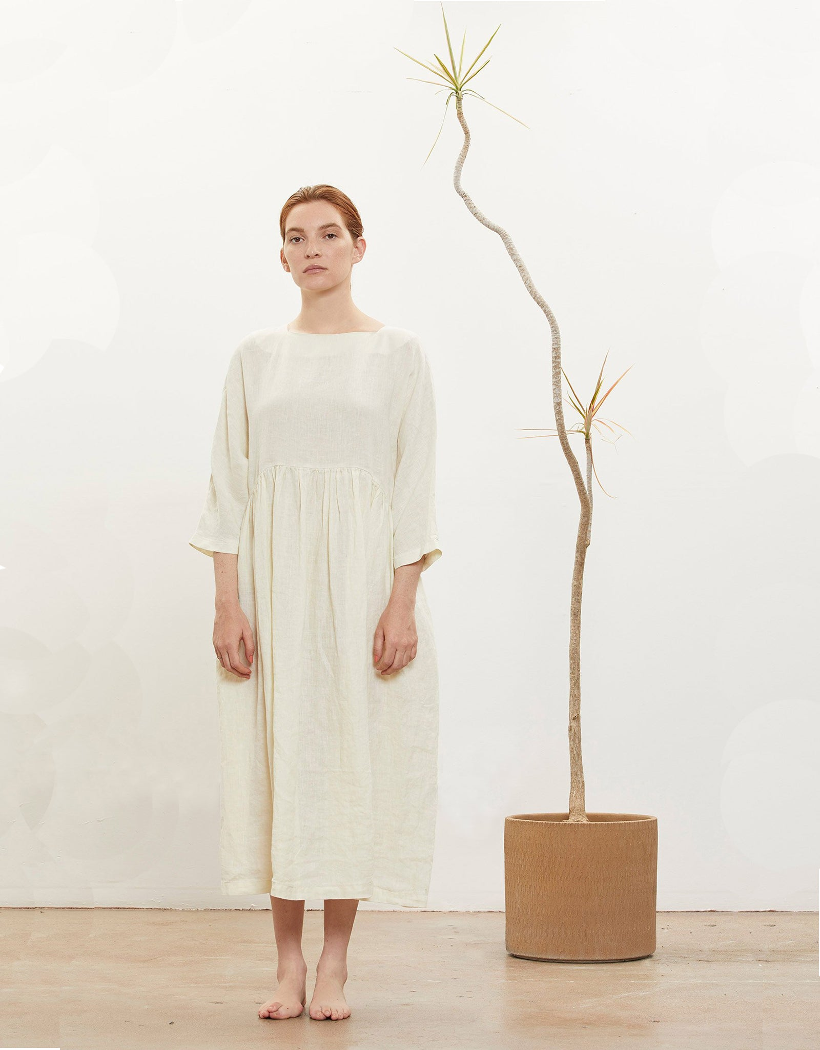 Model wears Black Crane Tradi Dress in Cream. Available at FAWN Toronto.