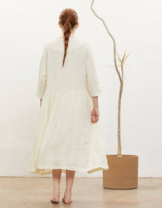 Model wears Black Crane Tradi Dress in Cream, back. Available at FAWN Toronto.