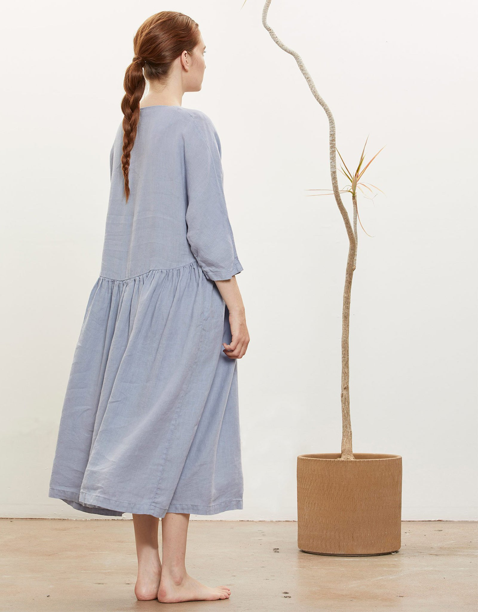 Model wears Black Crane Tradi Dress in Lavender, back. Available at FAWN Toronto.