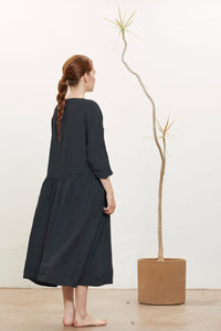 Model wears Black Crane Tradi Dress in Black, back. Available at FAWN Toronto.