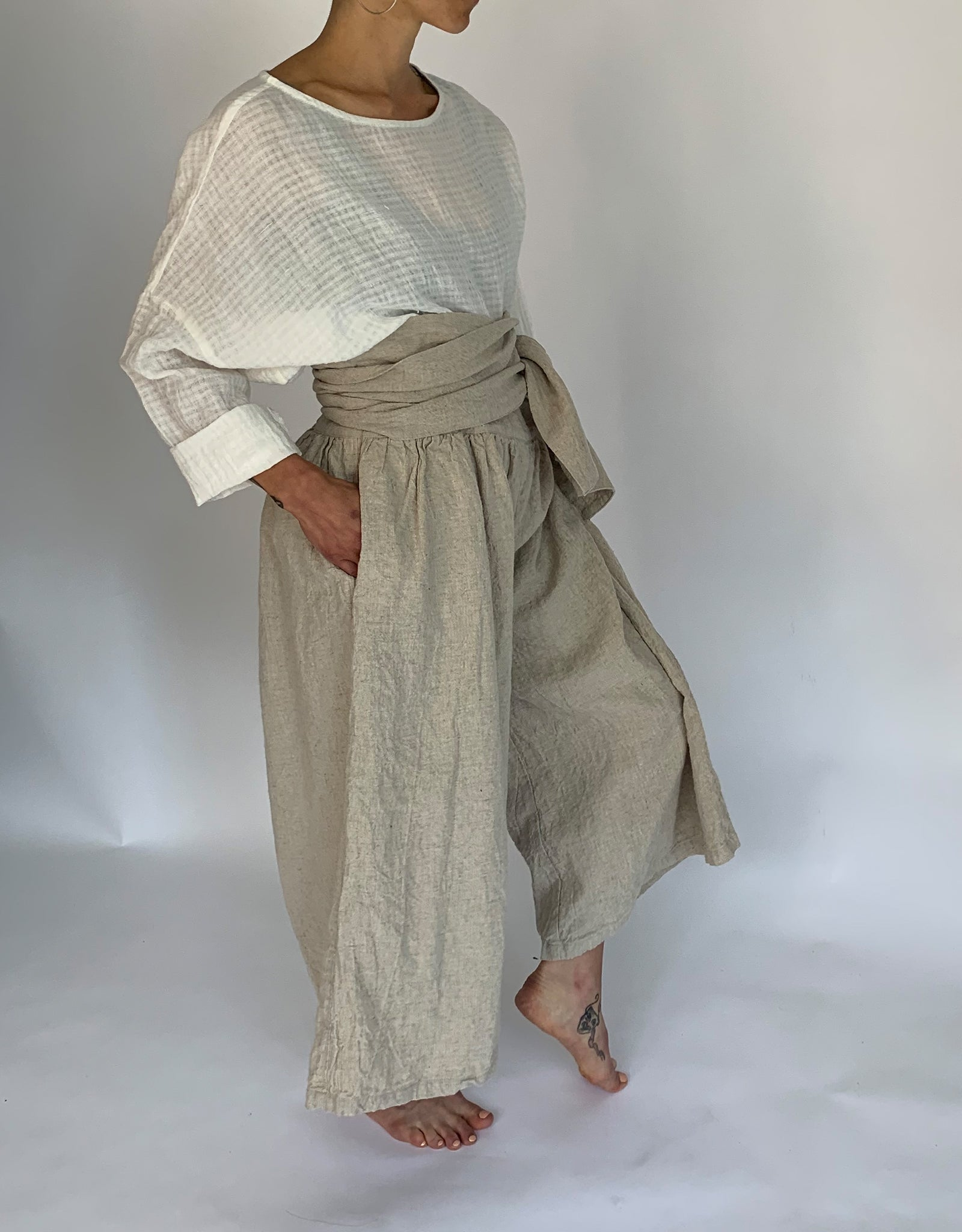 Model wears Ichi Antiquities Linen Tie Pant in Natural Linen, side. Available at FAWN Toronto.