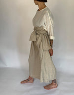 Load image into Gallery viewer, Model wears Ichi Antiquities Linen Tie Pant in Natural Linen, left side. Available at FAWN Toronto.
