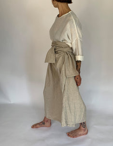 Model wears Ichi Antiquities Linen Tie Pant in Natural Linen, left side. Available at FAWN Toronto.