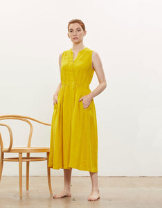 Model wears Black Crane Classy Tank Dress in Mustard.  Available at FAWN Toronto.