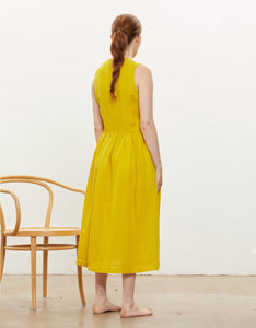 Model wears Black Crane Classy Tank Dress in Mustard, back. Available at FAWN Toronto.