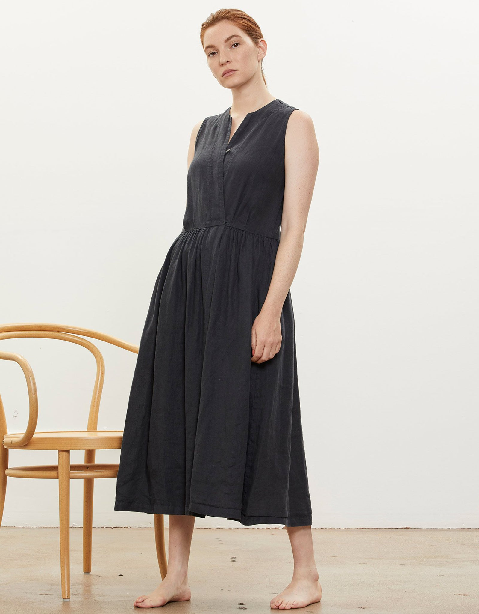 Model wears Black Crane Classy Tank Dress in Black. Available at FAWN Toronto.