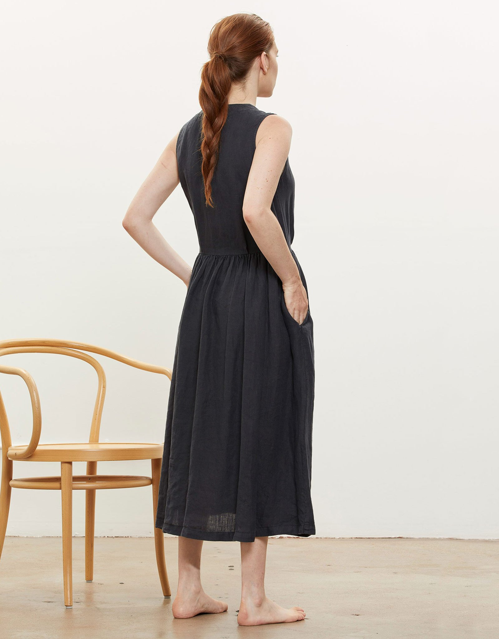 Model wears Black Crane Classy Tank Dress in Black, back. Available at FAWN Toronto.