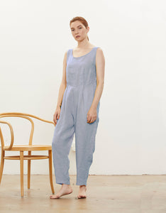 Model wears Black Crane Overall in Lavender.  Available at FAWN Toronto.