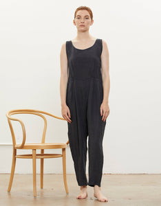 Model wears Black Crane Overall in Black. Available at FAWN Toronto.