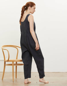 Model wears Black Crane Overall in Black, side.  Available at FAWN Toronto.