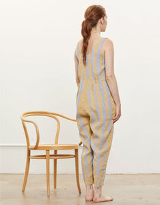 Model wears Black Crane Overall in Tan with Lavender stripe, back. Available at FAWN Toronto.