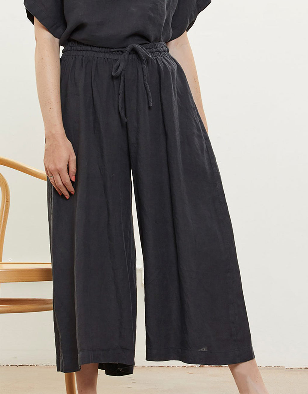 Model wears Black Crane Wide Culottes in Black. Available at FAWN Toronto.
