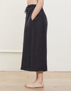 Model wears Black Crane Wide Culottes in Black, side. Available at FAWN Toronto.