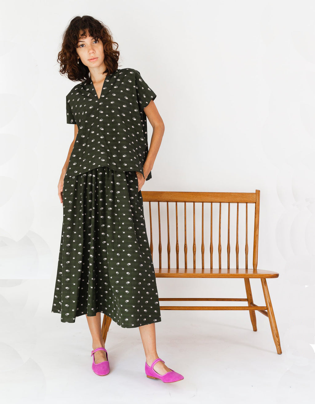Model wears Caron Callahan Selma Dress in Olive.Available at FAWN Toronto.