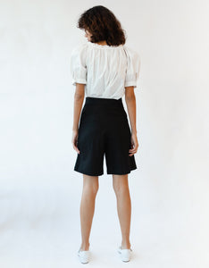 Model wears Caron Callahan Inez Short in Black, back. Available at FAWN Toronto.