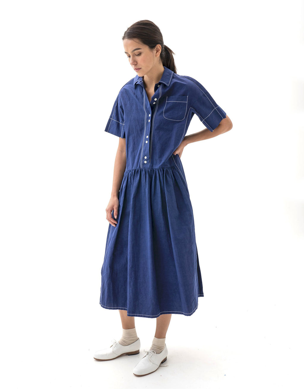 Model wears Caron Callahan blue Trista Dress. Available at FAWN Toronto.