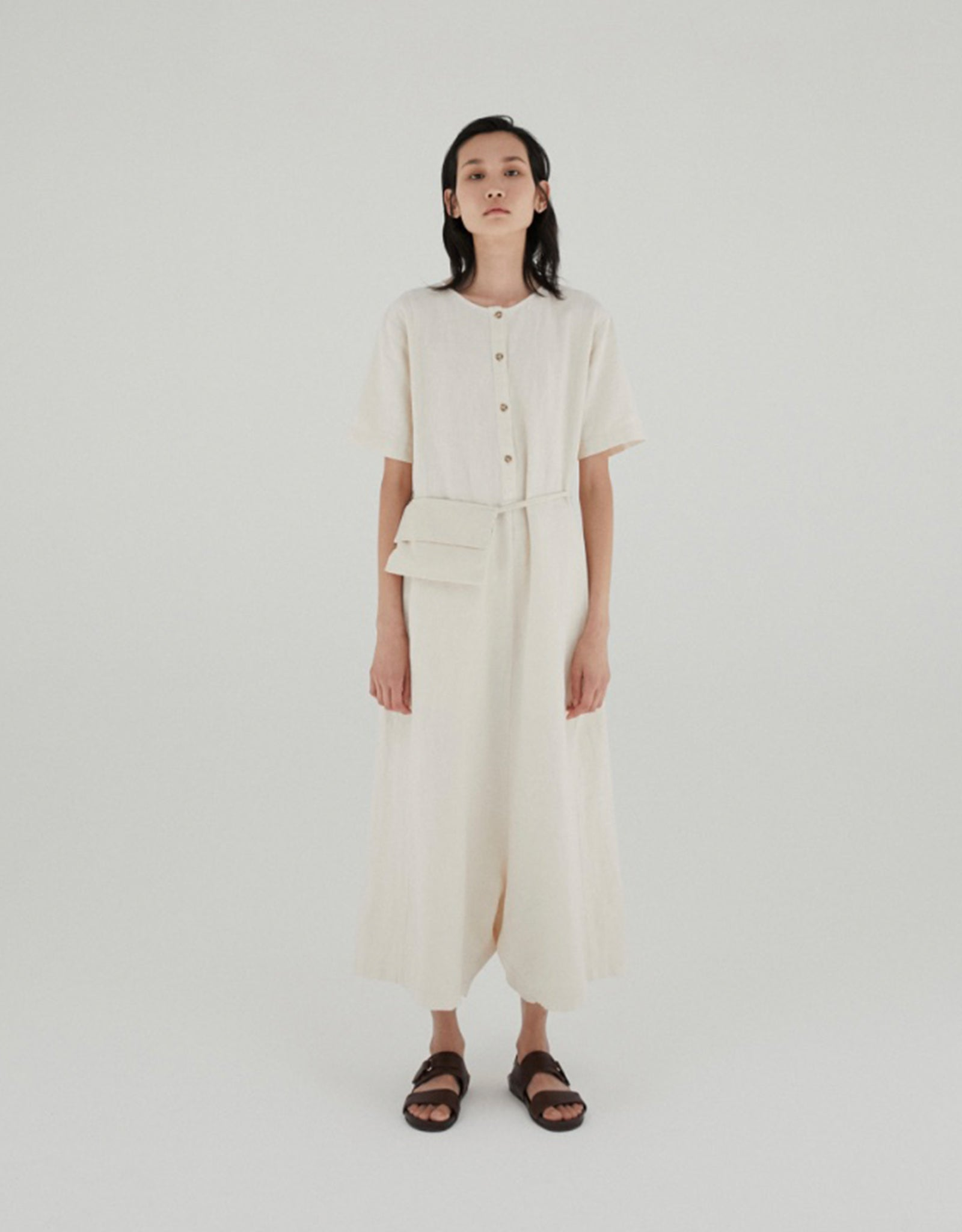 Model wears Monica Cordera Waist Belt Jumpsuit in Ivory. Available at FAWN Toronto.