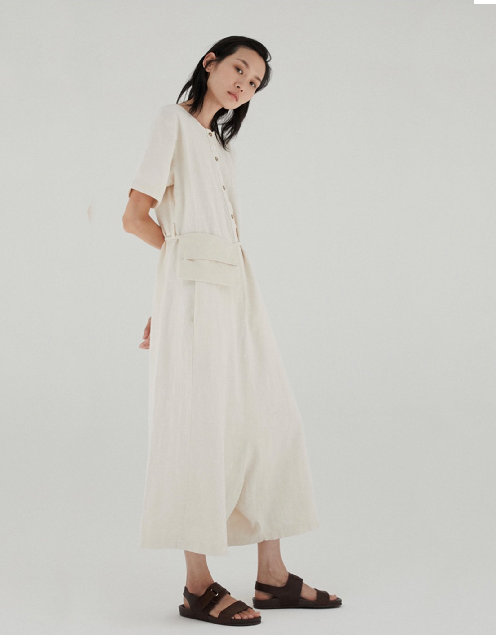 Model wears Monica Cordera Waist Belt Jumpsuit in Ivory, side. Available at FAWN Toronto.