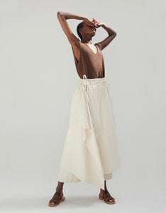 Model wears Monica Cordera Ramie Pareo Pant in Ivory.