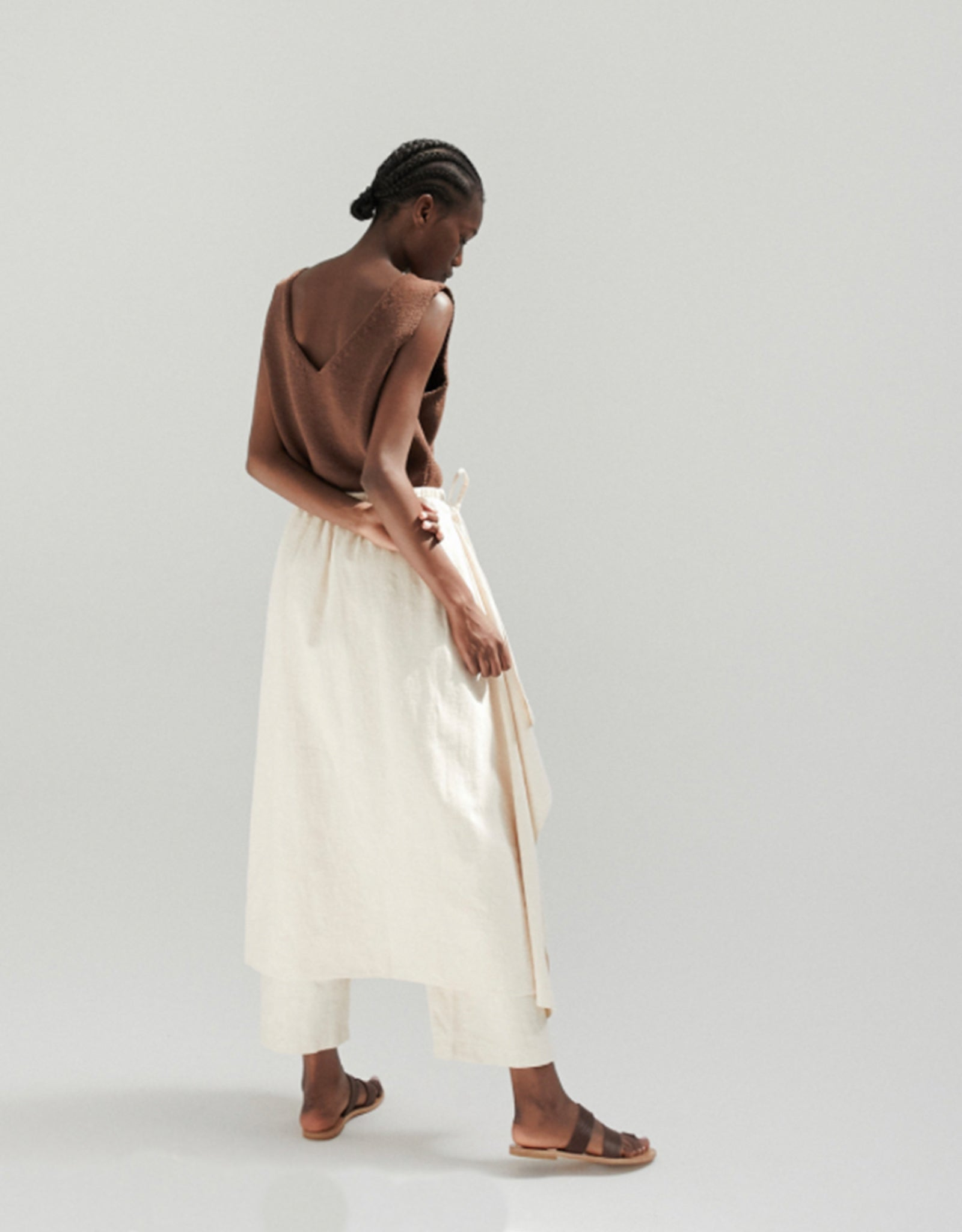 Model wears Monica Cordera Ramie Pareo Pant in Ivory, back.