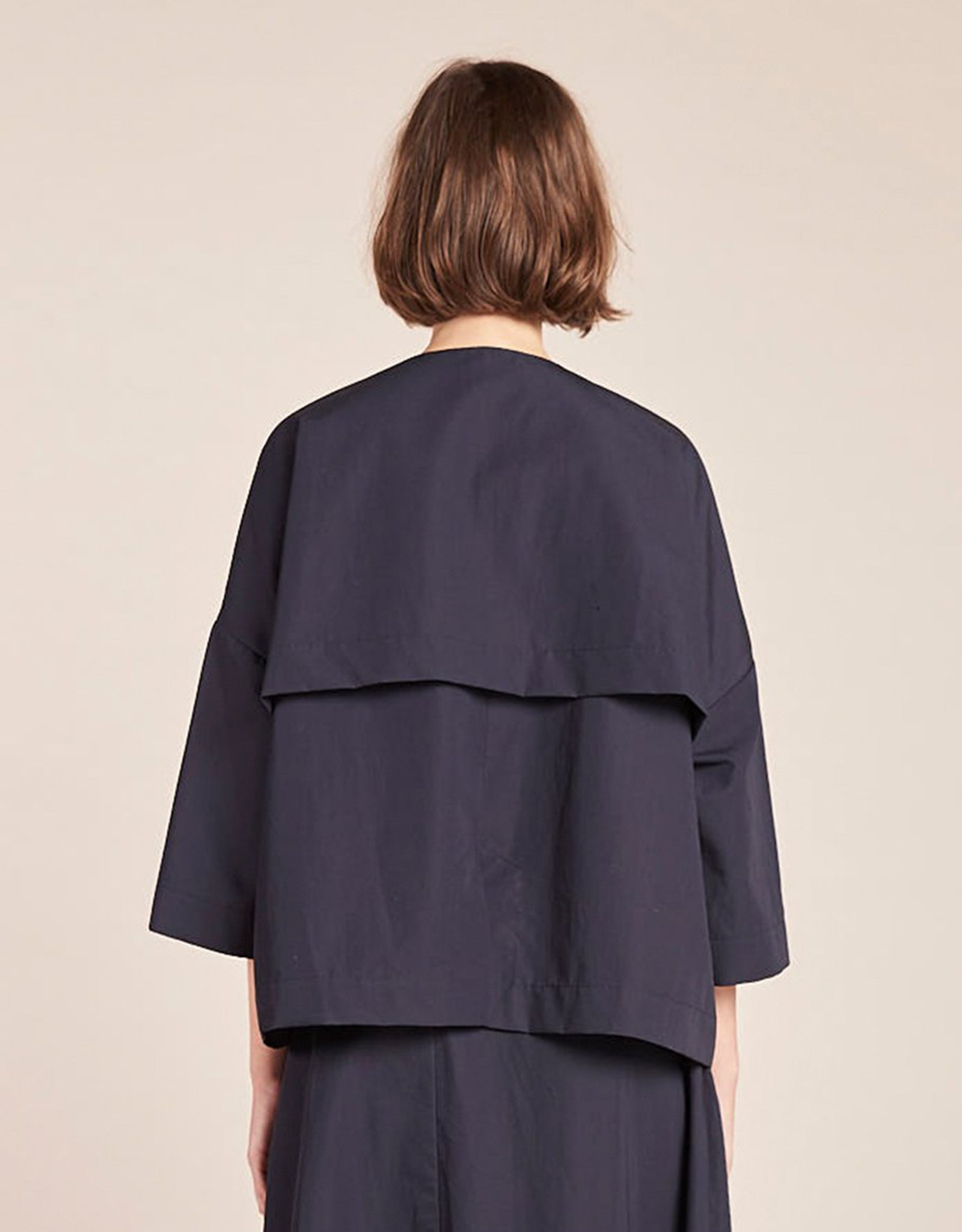 Model wears Kloke Amend Jacket in Ink, back. Available at FAWN Toronto.