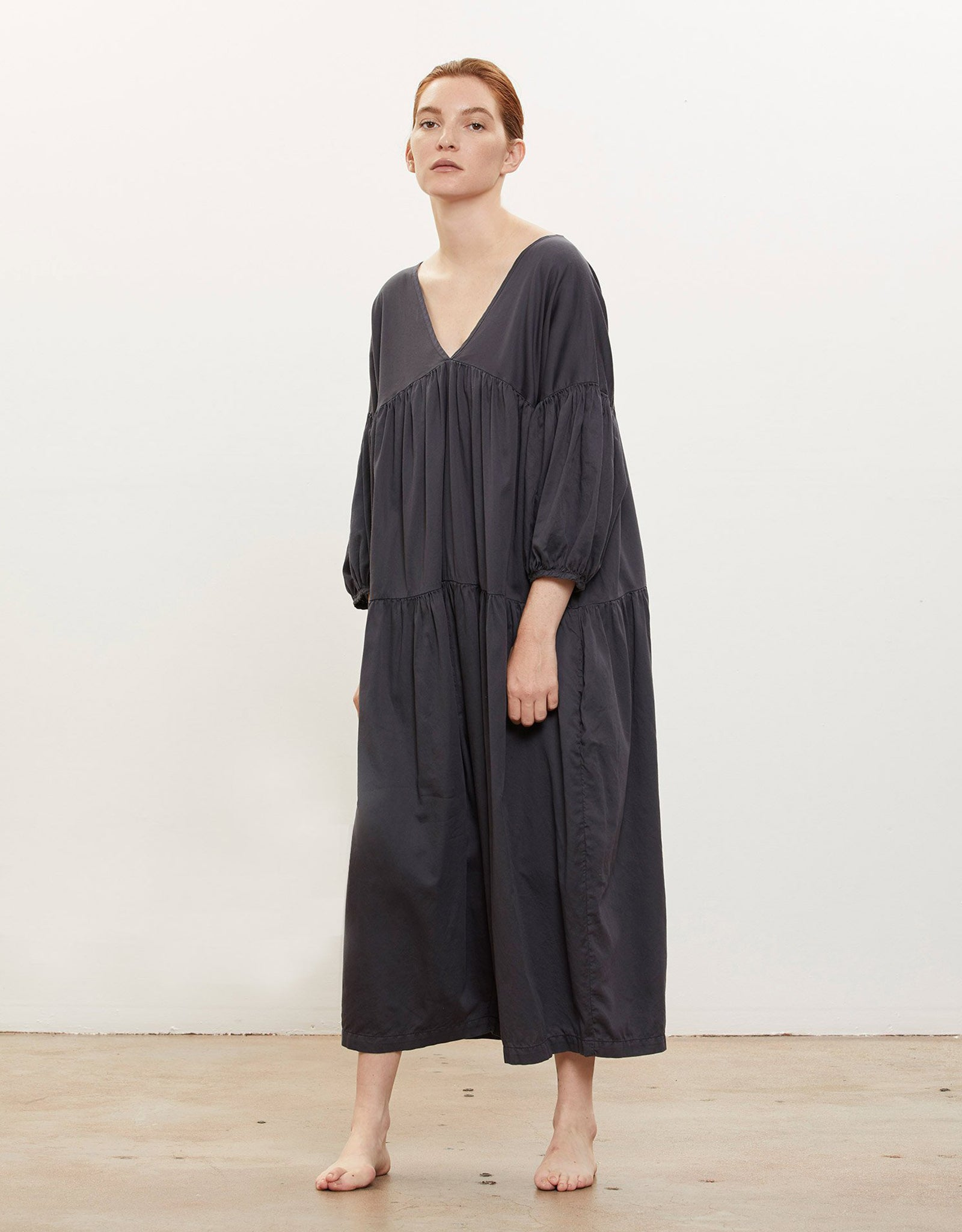 Model wears Black Crane Puff Jumpsuitin Faded Black. Available at FAWN Toronto.